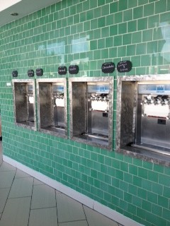 Four self serve Fro- Yo machines.